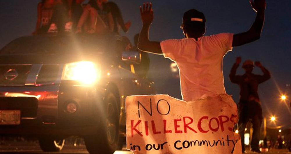 08.18.14news-ap-ferguson-killer-cops-edit